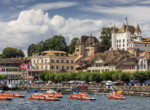Nyon panorama with pedal boats in Lake Geneva